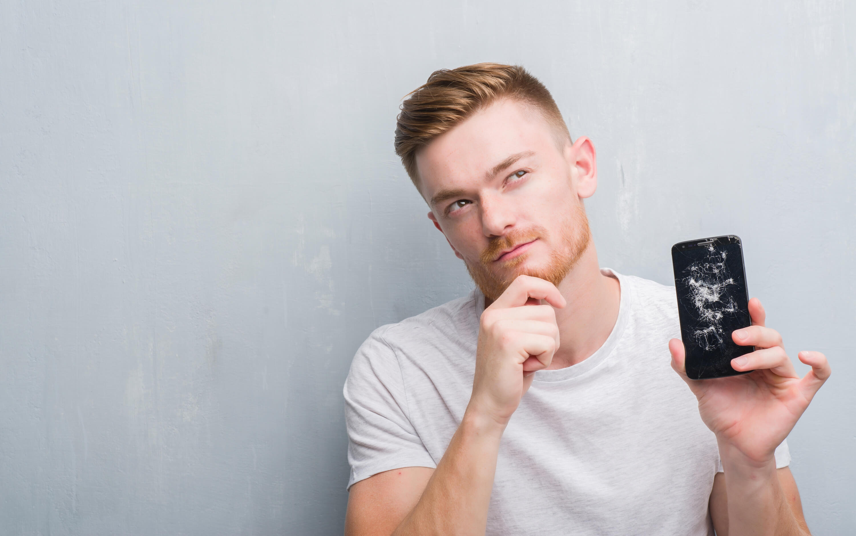 man wondering where to sell cracked iPhone online for cash