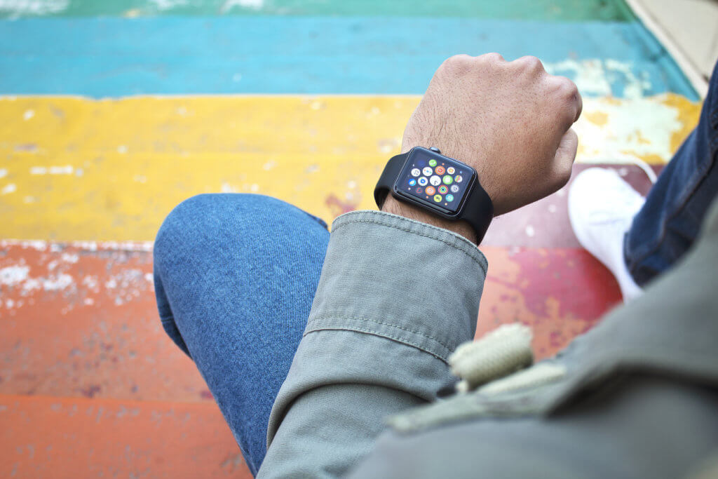hand using watch on top view
