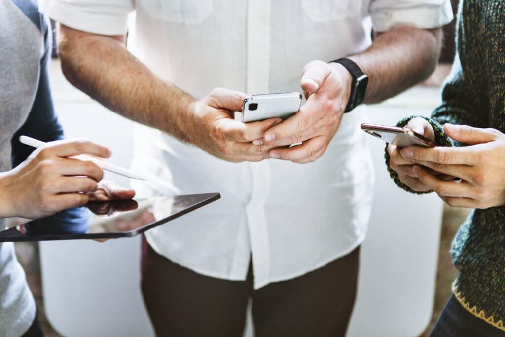Group of people on their devices
