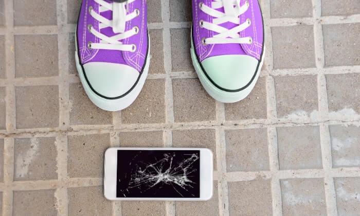 Damaged phone on ground